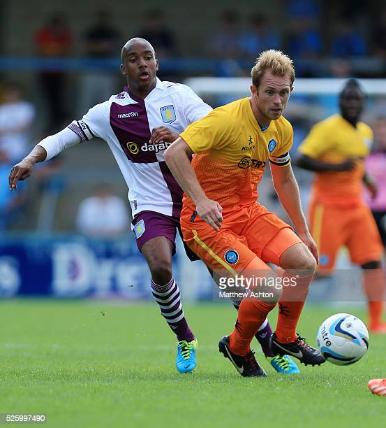 Fabian Delph of Aston Villa and Stuart Lewis of Wycombe Wanderers