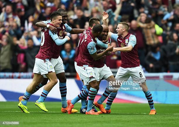 Fabian Delph of Aston Villa celebrates scoring Aston Villa's 2nd goal with team-mates during the FA Cup Semi-Final match between Aston Villa and...