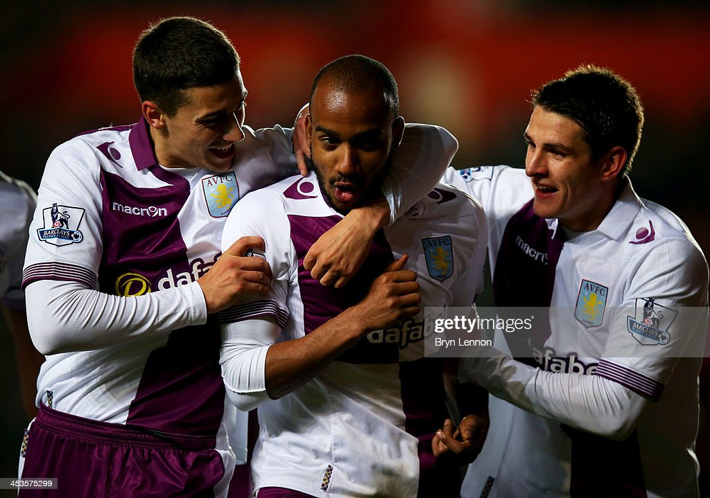 Fabian Delph of Aston Villa (C) celebrates with team mates Matthew Lowton (L) and Ashley Westwood (R) as he scores their third goal during the Barclays Premier League match between Southampton and Aston Villa at St Mary's Stadium on December 4, 2013 in Southampton, England.