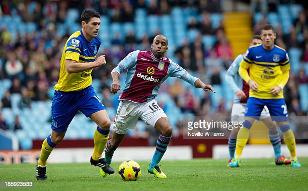 Fabian Delph of Aston Villa challenged by Gareth Barry of Everton during the Barclays Premier League match between Aston Villa and Everton at Villa...