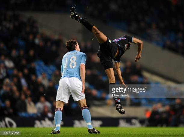 Fabian Delph of Aston Villa collides with Gareth Barry of Manchester City during the FA Cup sponsored by EOn Fifth Round match between Manchester...