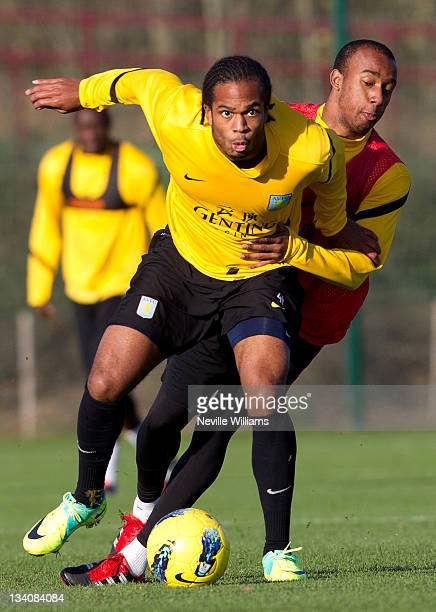 Fabian Delph of Aston Villa in action with team mate Nathan Delfouneso during an Aston Villa training session at the club's training ground at...