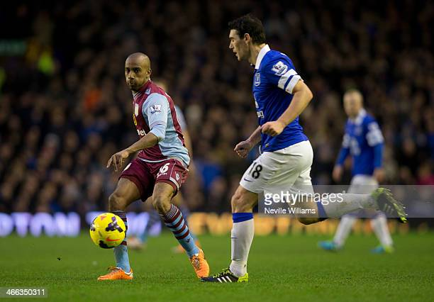 Fabian Delph of Aston Villa is challenged by Gareth Barry of Everton during the Barclays Premier League match between Everton and Aston Villa at...