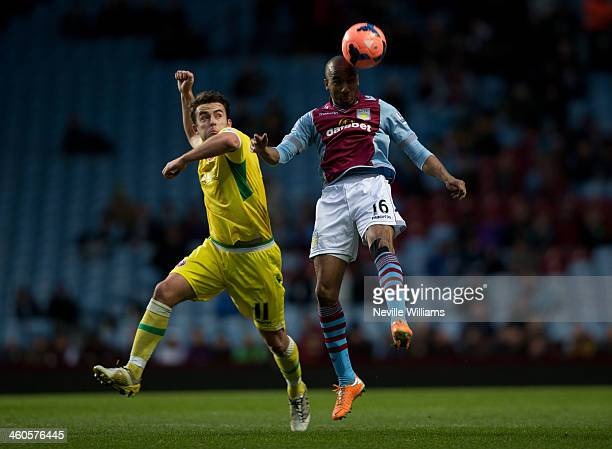 Fabian Delph of Aston Villa is challenged by Jose Baxter of Sheffield United during the FA Cup Third Round match between Aston Villa and Sheffield...