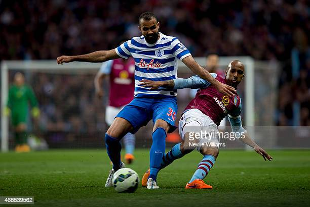 Fabian Delph of Aston Villa is challenged by Sandro of Queens Park Rangers during the Barclays Premier League match between Aston Villa and Queens...