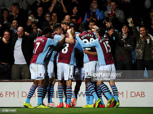 Fabian Delph of Aston Villa is congratulated by team mates as he scores their first goal during the Barclays Premier League match between Aston Villa...