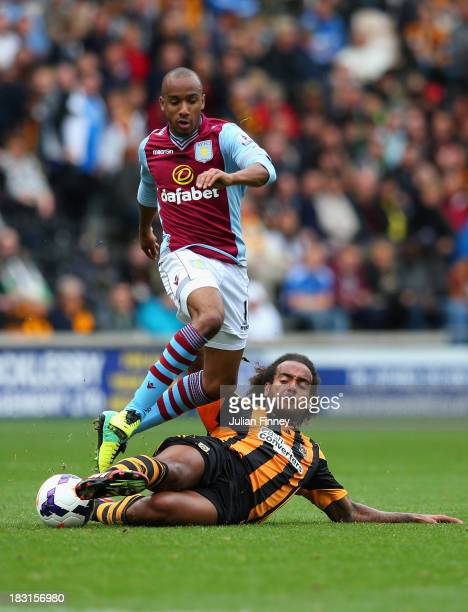 Fabian Delph of Aston Villa tackles Tom Huddlestone of Hull City during the Barclays Premier League match between Hull City and Aston Villa at KC...