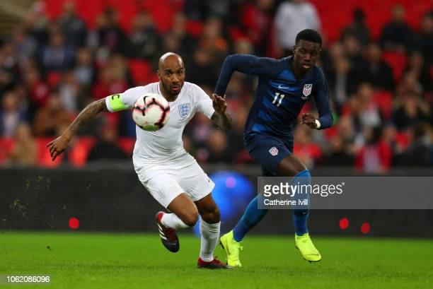 Fabian Delph of England competes with Tim Weah of USA during the International Friendly match between England and United States at Wembley Stadium on...