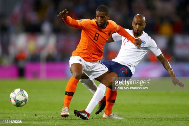Fabian Delph of England tackles Georginio Wijnaldum of The Netherlands during the UEFA Nations League SemiFinal match between the Netherlands and...