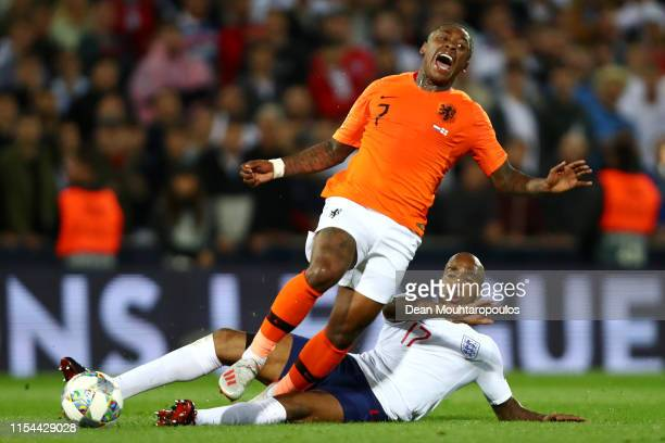 Fabian Delph of England tackles Steven Bergwijn of The Netherlands during the UEFA Nations League SemiFinal match between the Netherlands and England...