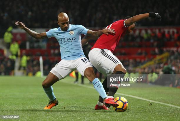 Fabian Delph of Manchester City and Anthony Martial of Manchester United in action during the Premier League match between Manchester United and...