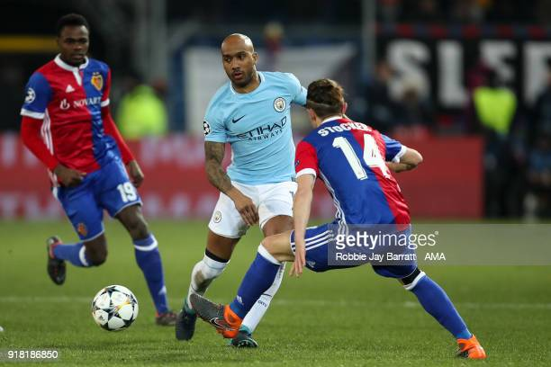 Fabian Delph of Manchester City and Valentin Stocker of FC Basel during the UEFA Champions League Round of 16 First Leg match between FC Basel and...
