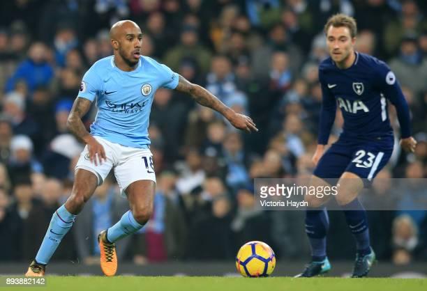 Fabian Delph of Manchester City attempts to get away from Christian Eriksen of Tottenham Hotspur during the Premier League match between Manchester...