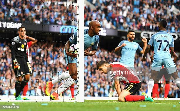 Fabian Delph of Manchester City celebrates after Jermain Defoe of Sunderland scores a own goal to score Manchester City's second goal during the...