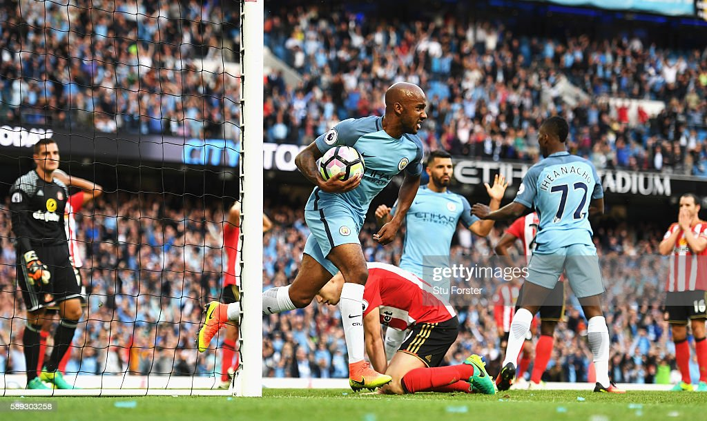 Fabian Delph of Manchester City celebrates after Paddy McNair of Sunderland scored a own goal for Manchester City's second goal of the game during the Premier League match between Manchester City and Sunderland at Etihad Stadium on August 13, 2016 in Manchester, England.