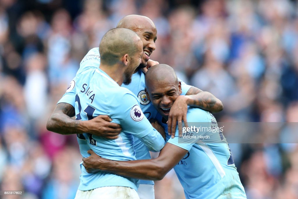 Fabian Delph of Manchester City celebrates scoring his sides fifth goal with his Manchester City team mates during the Premier League match between Manchester City and Crystal Palace at Etihad Stadium on September 23, 2017 in Manchester, England.