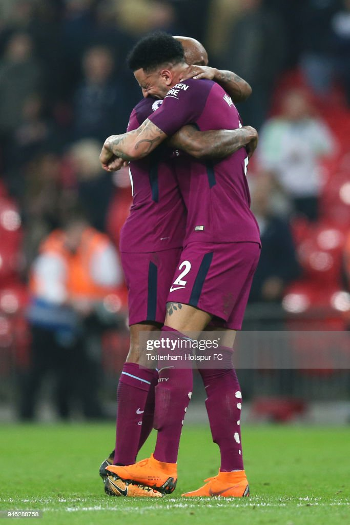 Fabian Delph of Manchester City celebrates victory with Kyle Walker of Manchester City after the Premier League match between Tottenham Hotspur and Manchester City at Wembley Stadium on April 14, 2018 in London, England.