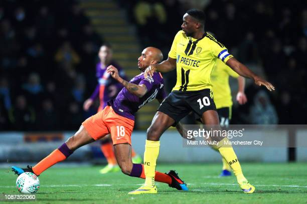 Fabian Delph of Manchester City clears the ball from Lucas Akins of Burton Albion during the Carabao Cup Semi Final Second Leg match between Burton...