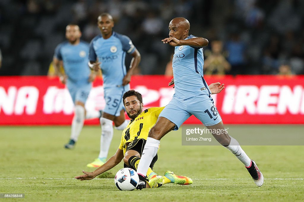 Fabian Delph (L) of Manchester City contests the ball against Nuri Sahin of Borussia Dortmund during the 2016 International Champions Cup match between Manchester City and Borussia Dortmund at Shenzhen Universiade Stadium on July 28, 2016 in Shenzhen, China.