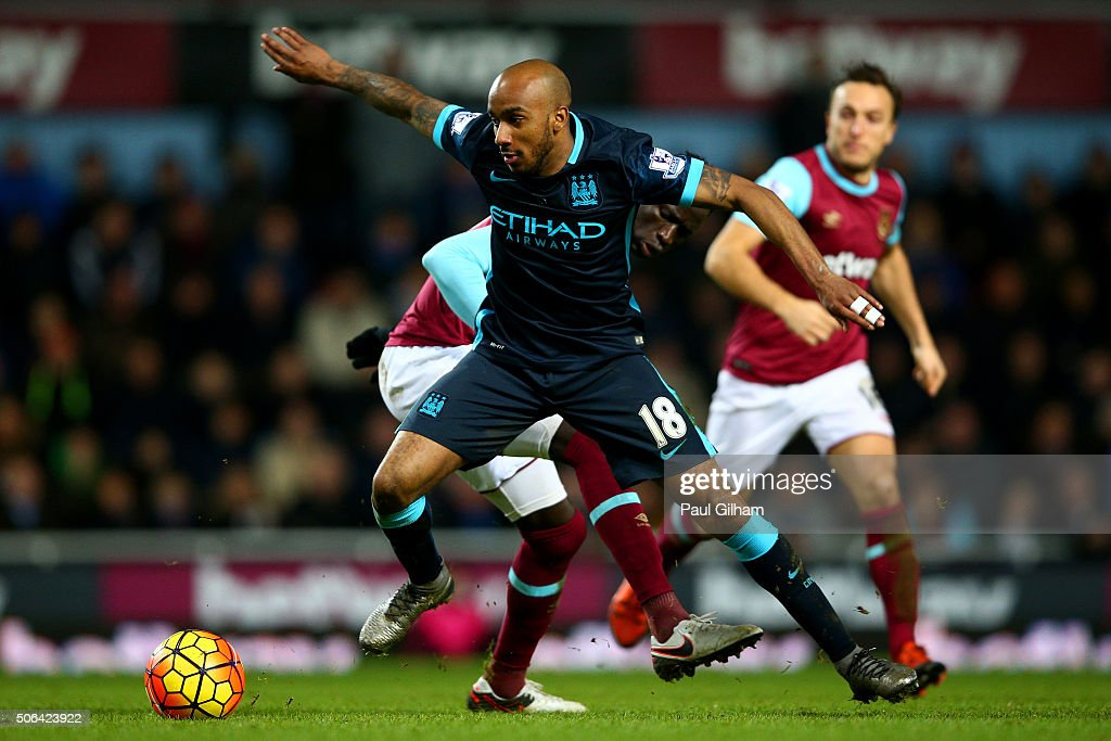 Fabian Delph of Manchester City evades Cheikhou Kouyate of West Ham United during the Barclays Premier League match between West Ham United and Manchester City at the Boleyn Ground on January 23, 2016 in London, England.
