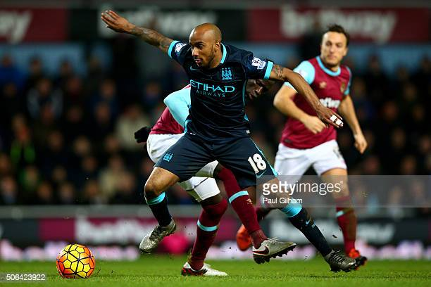 Fabian Delph of Manchester City evades Cheikhou Kouyate of West Ham United during the Barclays Premier League match between West Ham United and...