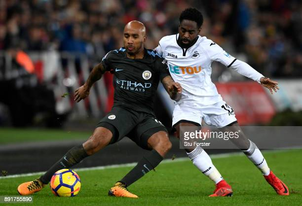Fabian Delph of Manchester City is challenged by Nathan Dyer of Swansea City during the Premier League match between Swansea City and Manchester City...