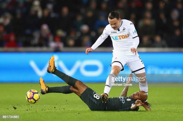 Fabian Delph of Manchester City is fouled by Roque Mesa of Swansea City during the Premier League match between Swansea City and Manchester City at...