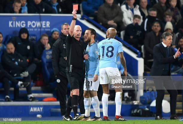 Fabian Delph of Manchester City is shown a red card by referee Mike Dean during the Premier League match between Leicester City and Manchester City...