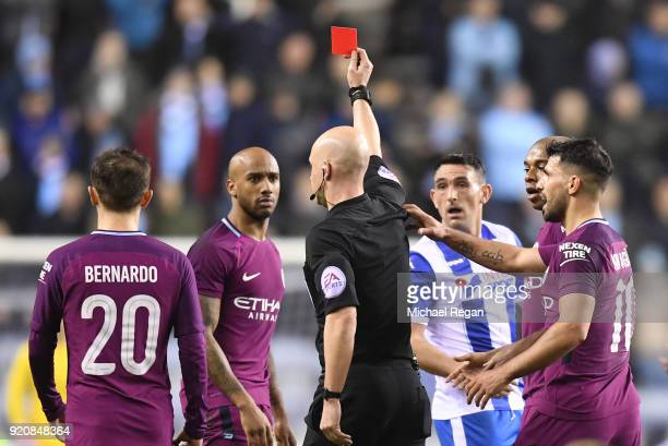 Fabian Delph of Manchester City is shown a red card by referee Anthony Taylor during the Emirates FA Cup Fifth Round match between Wigan Athletic and...