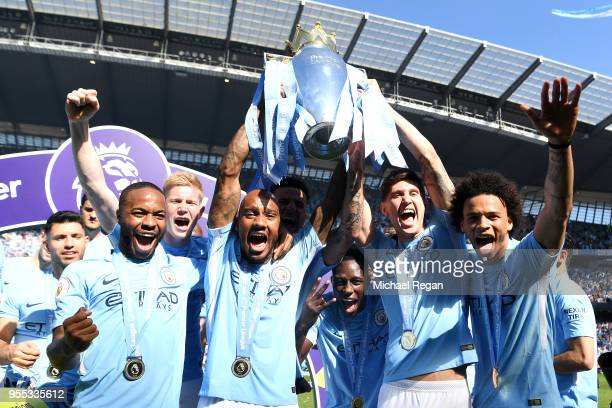 Fabian Delph of Manchester City lifts The Premier League Trophy after the Premier League match between Manchester City and Huddersfield Town at...