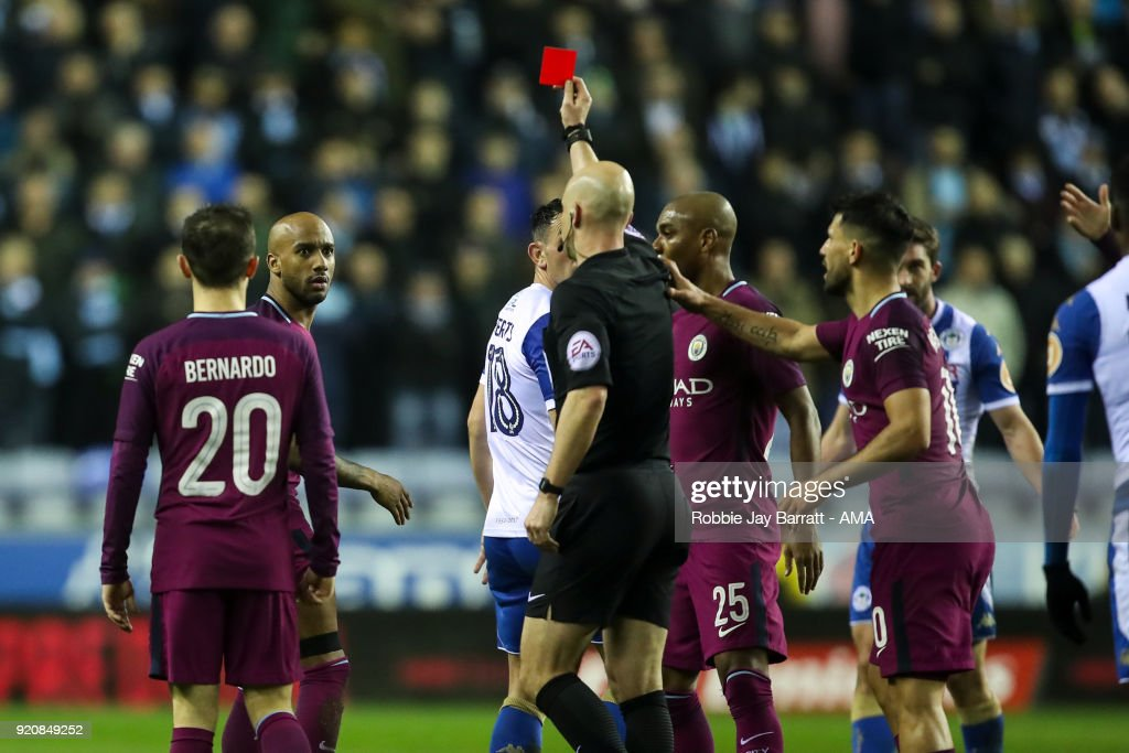 Fabian Delph of Manchester City receives a straight red card during The Emirates FA Cup Fifth Round match between Wigan Athletic and Manchester City at DW Stadium on February 19, 2018 in Wigan, England.