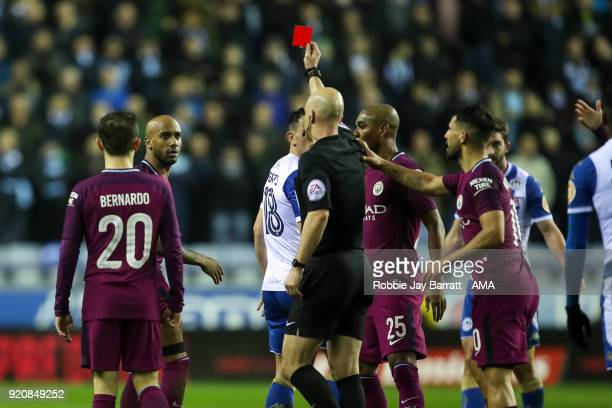 Fabian Delph of Manchester City receives a straight red card during The Emirates FA Cup Fifth Round match between Wigan Athletic and Manchester City...