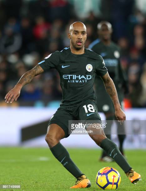 Fabian Delph of Manchester City runs with the ball during the Premier League match between Swansea City and Manchester City at Liberty Stadium on...