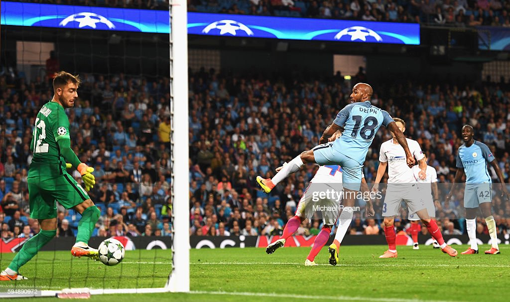 Fabian Delph of Manchester City scores the opening goal during the UEFA Champions League Play-off Second Leg match between Manchester City and Steaua Bucharest at Etihad Stadium on August 24, 2016 in Manchester, England.
