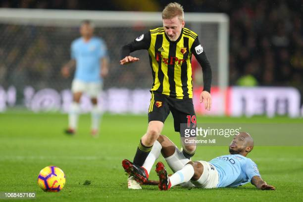 Fabian Delph of Manchester City tackles Will Hughes of Watford during the Premier League match between Watford FC and Manchester City at Vicarage...