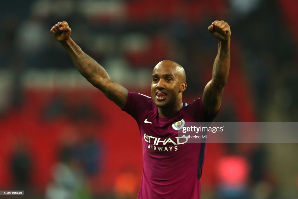 Fabian Delph of Mnchester City celebrates victory after the Premier League match between Tottenham Hotspur and Manchester City at Wembley Stadium on April 14, 2018 in London, England.