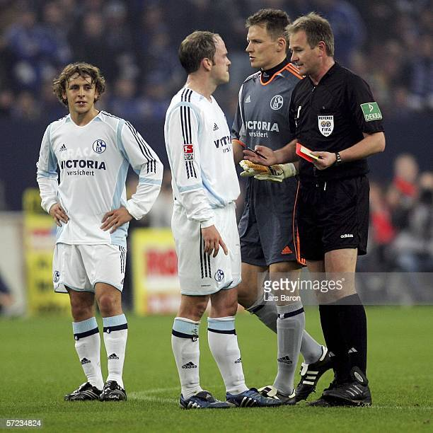 Fabian Ernst and goalkeeper Frank Rost of Schalke discus with Referee Helmut Fleischer after he gaves Rafinha of Schalke the red card during the...