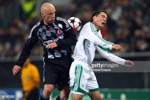 Fabian Ernst of Besiktas Istanbul and Marcel Schaefer of Wolfsburg go up for a header during the UEFA Champions League Group B first leg match...