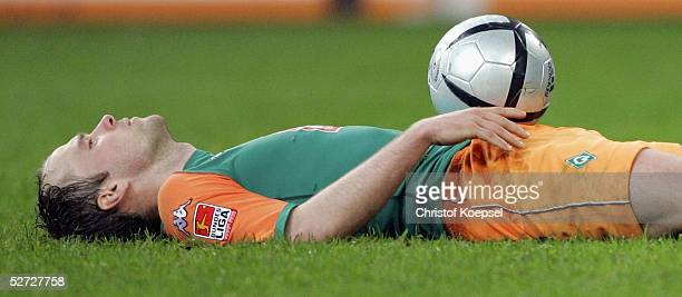Fabian Ernst of Bremen lays on the ground during the DFB Pokal Semi Final Match between FC Schalke 04 and Werder Bremen, at the Arena auf Schalke on...