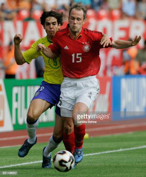 Fabian Ernst of Germany challenges Kaka of Brazil during the FIFA Confederations Cup Semi Final match between Germany and Brazil on June 25, 2005 at...