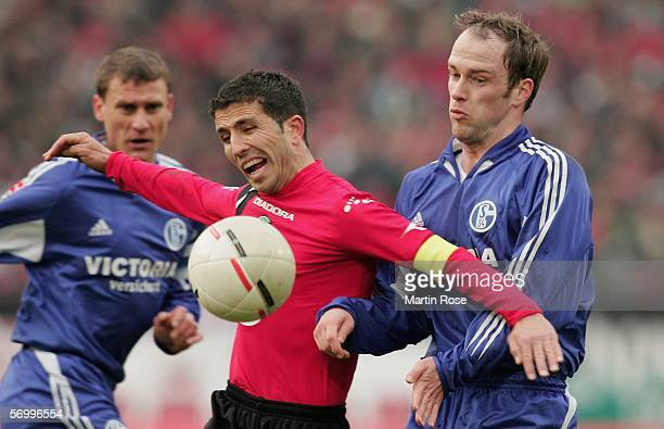 Fabian Ernst of Schalke challenges Altin Lala of Hannoverduring the Bundesliga match between Hanover 96 and FC Schalke 04 at the AWD Arena on March 4...