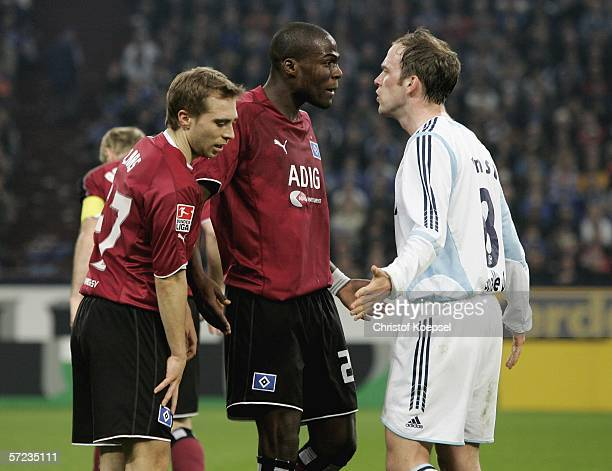 Fabian Ernst of Schalke has a struggle with Guy Demel of Hamburg during the Bundesliga match between FC Schalke 04 and Hamburger SV at the Veltins...