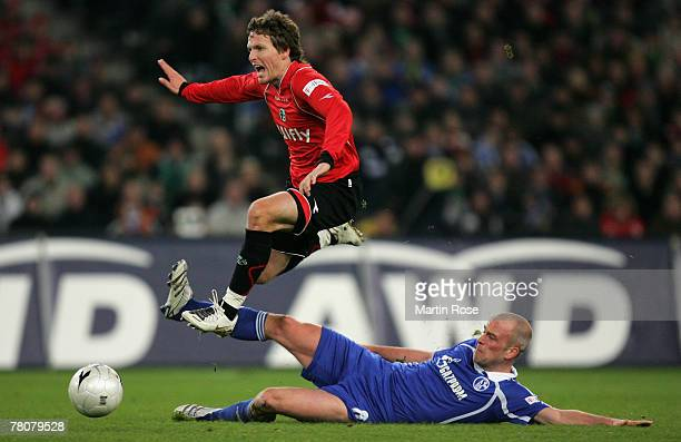 Fabian Ernst of Schalke tries to stop Benny Lauth of Hanover during the Bundesliga match between Hanover 96 and Schalke 04 at the AWD Arena on...