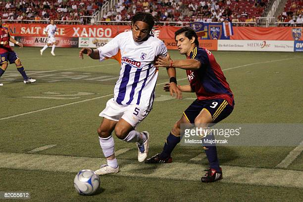 Fabian Espindola of Real Salt Lake goes after the ball against Victor Cordero of Deportivo Saprissa at Rice Eccles Stadium on July 23 2008 in Salt...