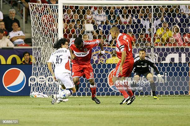 Fabian Espindola of Real Salt Lake goes in for the goal against CJ Brown and Dasan Robinson of Chicago Fire at Rio Tinto Stadium on September 12 2009...