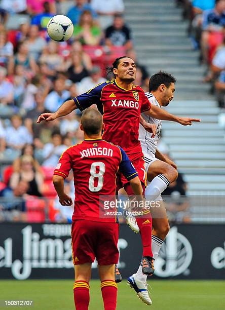 Fabian Espindola of Real Salt Lake goes up for a header against Jun Marques Davidson of the Vancouver Whitecaps while Will Johnson of Real Salt Lake...
