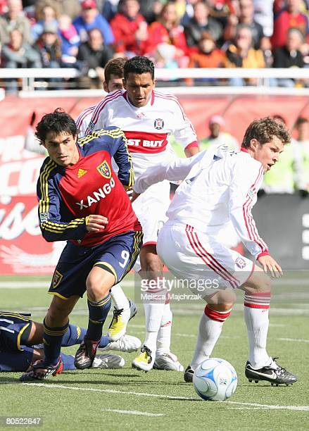 Fabian Espindola of the Real Salt Lake looks to go after the ball against Logan Pause of the Chicago Fire at Rice Eccels Stadium on March 29, 2008 in...