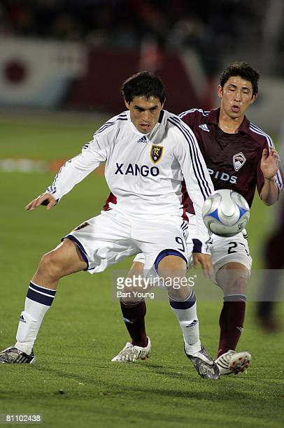 Fabian Espindola Real Salt Lake fights for the ball against Kosuke Kimura of the Colorado Rapids during the MLS game on May 15, 2008 at Dicks...