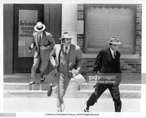 Fabian Forte Adam Rourke and Michael Haynes run from bank in a scene from the film 'A Bullet For Pretty Boy' 1970