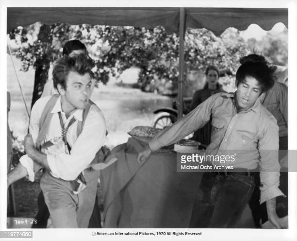 Fabian Forte beats down Hugh Feagin in a scene from the film 'A Bullet For Pretty Boy' 1970